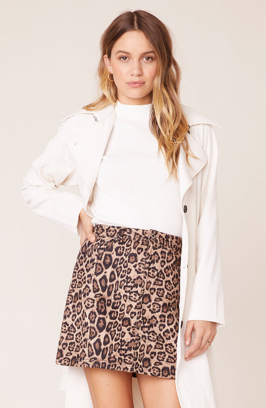 Model wearing leopard print faux suede mini skirt