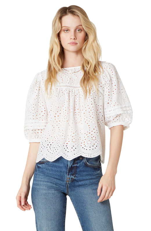 The Take a Moment top features a lighweight cotton eyelet fabric and has feminine flair with it's three quarter puffed sleeves and a scalloped hem.