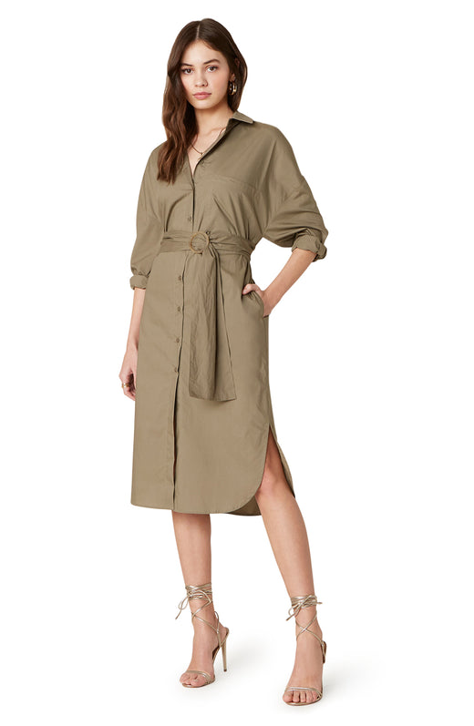 The Boyfriend's Back is a crisp 100% cotton knee-length shirt dress with a button front and trendy ring-belted waist.