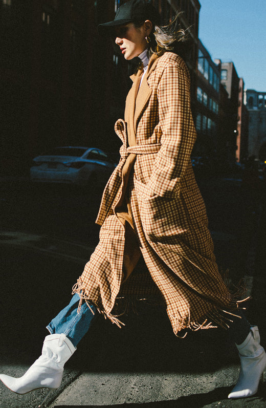 midi length plaid overcoat with self fringe hem, tie belt, patch pockets and solid colored lapel.