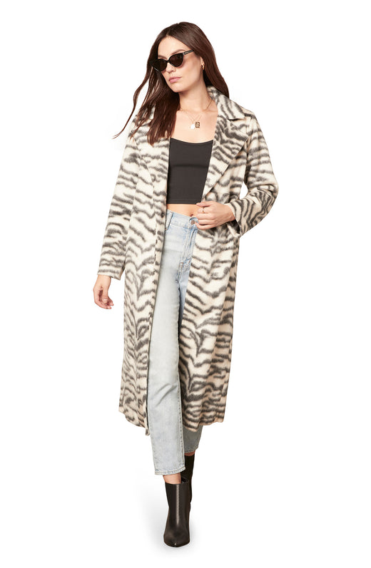 ivory colored plush faux fur midi length coat with a striped animal print and single snap button closure.