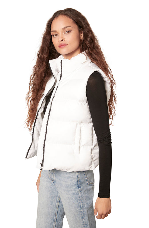 white colored sporty quilted puffer vest with a subtle camo pattern, zip front, and pockets.