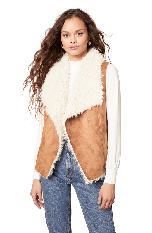 dark camel colored faux suede vest with bonded faux shearling lining and a knit back. It features a draped open front silhouette and slit pockets.
