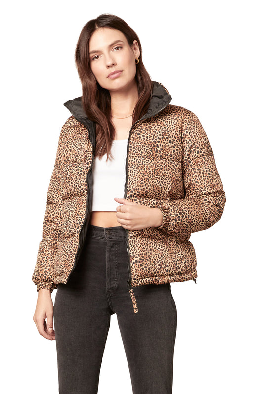 reversible quilted puffer jacket with a leopard print on one side and solid black on the reverse. It features a zip front closure and zippered pockets.