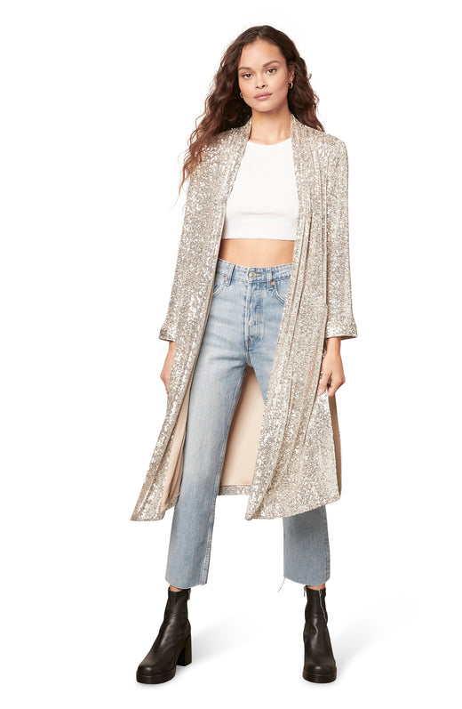 silver midi length sequin duster jacket in a slinky, open front silhouette with side slits and pockets.