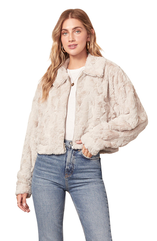 light tan colored swirl textured faux fur jacket with a boxy cropped fit and zip front closure.
