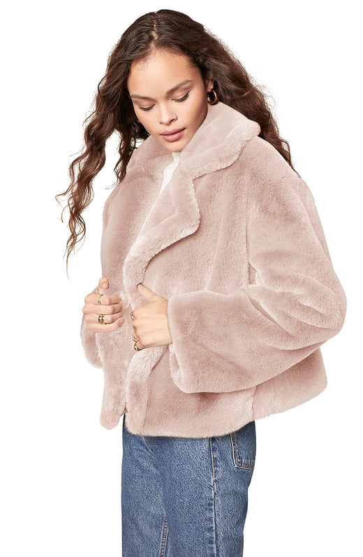 light taupe colored luxurious faux fur jacket with an oversize collar and open front.