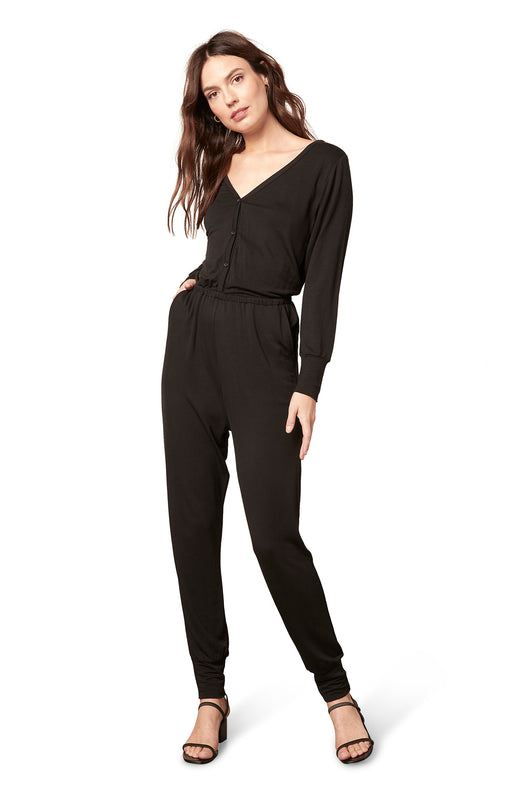black knit longsleeve loungewear jumpsuit with a fitted elastic waist and button front detail.