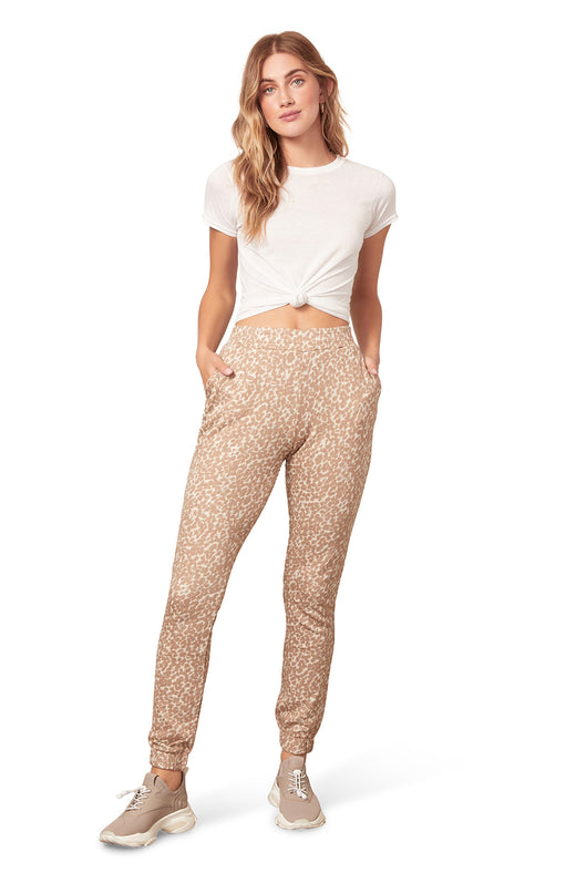 sand colored leopard spot printed jogger sweatpant with pockets.