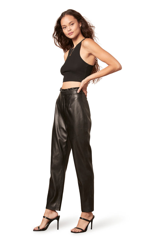 black colored high waisted vegan leather trouser with a paperbag waist, tapered leg, and zip front closure.