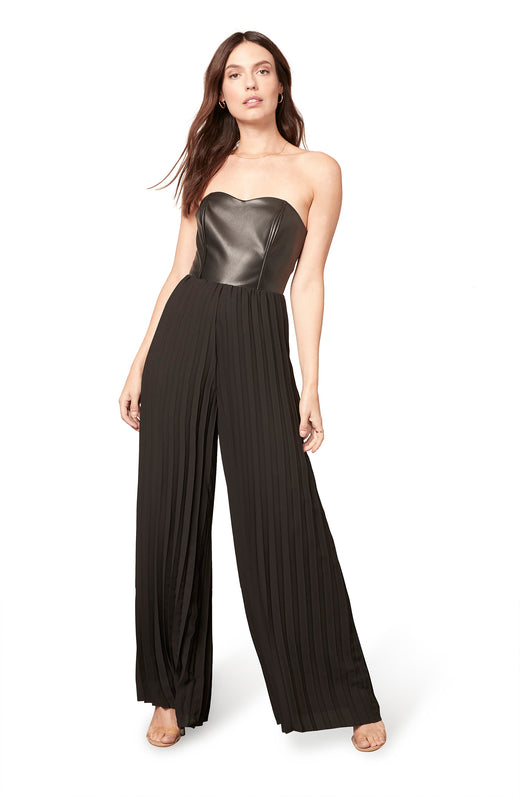 black pleated chiffon-leg jumpsuit with a vegan leather sweetheart bustier bodice. Back zip closure.