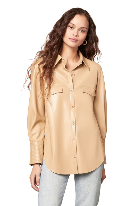 tan colored western-inspired vegan leather shirt with a button front and wide buttoned cuffs.