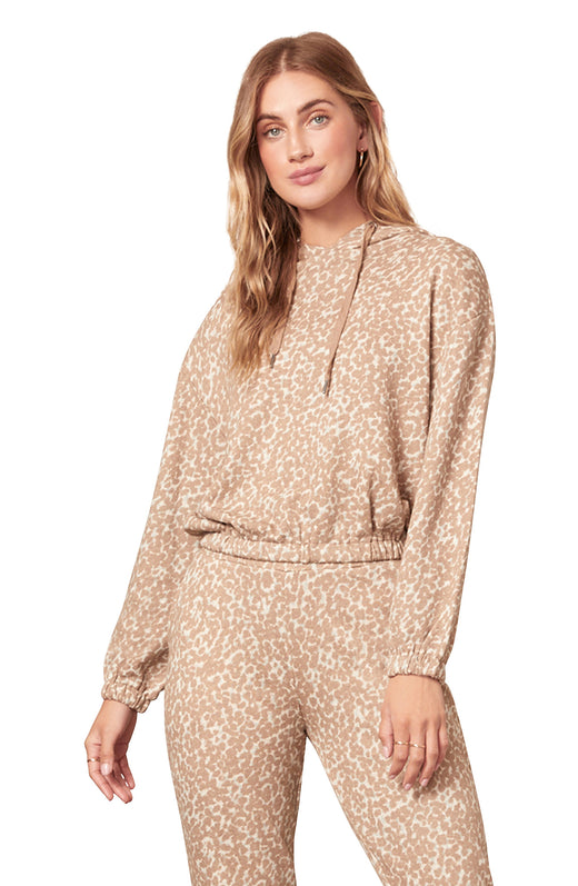 sand colored animal spot printed french terry hoodie with a cozy pullover silhouette and elasticized waist.
