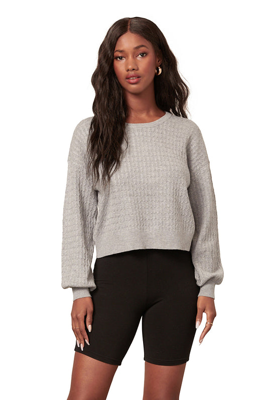 light grey color ultra soft sweater-knit pullover sweatshirt with blousant sleeves.