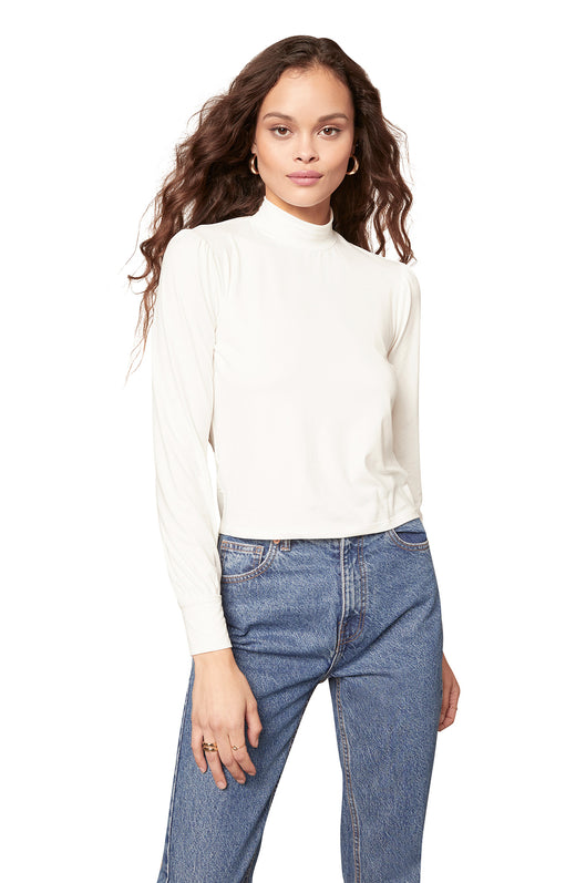 white soft peached jersey top with mock neckline and long sleeves.
