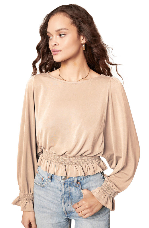 beige soft and drapey knit top with long dolman sleeves and a smocked peplum waist detail.