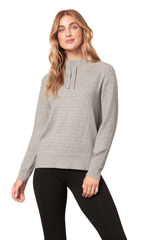 light heather grey ultra soft sweater knit funnel neck top with drawstring detail.