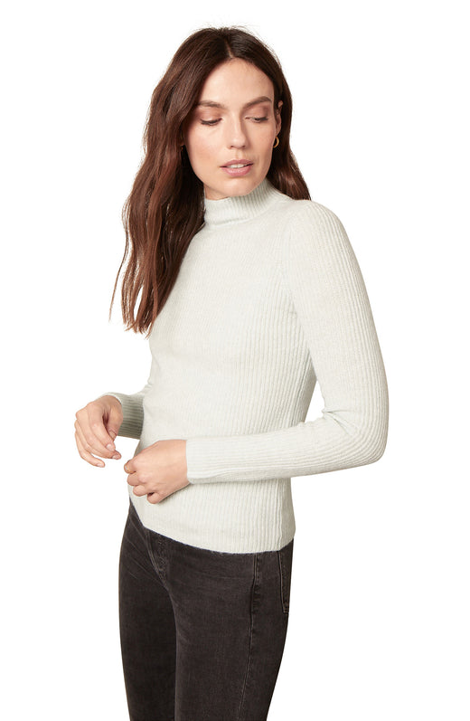 white ultra soft ribbed mockneck sweater with long sleeves.