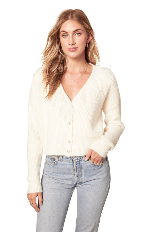 ivory white knit cardigan with pearlescent buttons and a feather-trimmed V-neckline.