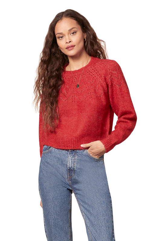 red colored drop needle detail yoke sweater with raglan sleeves and ribbed trim.