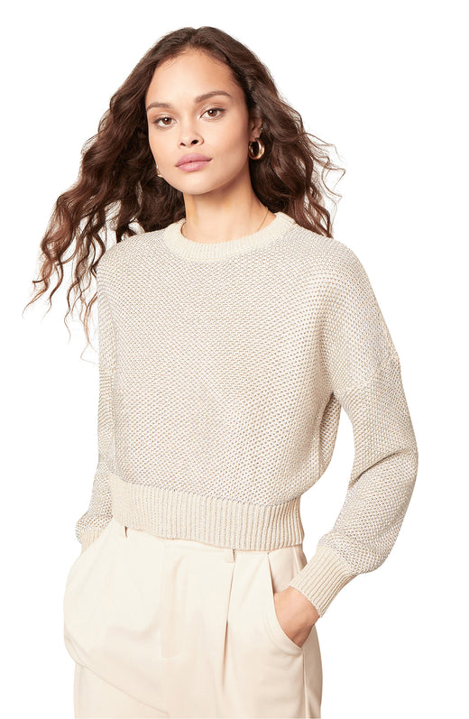 metallic honeycomb stitch sweater with a drop-shoulder dolman sleeve silhouette and ribbed trim.