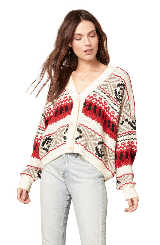 red, white, black, tan fairisle striped cardigan with a three button closure, V-neckline, and boxy drop shoulder silhouette.