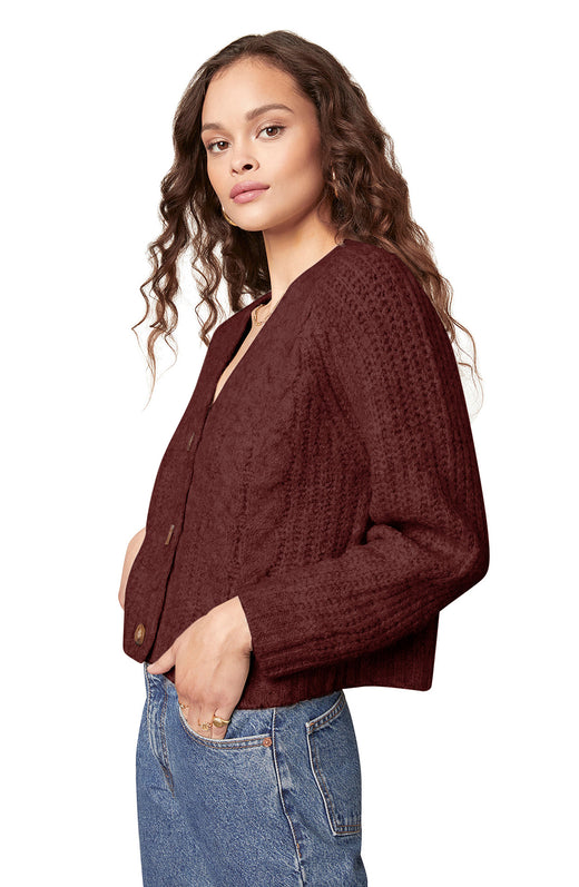 brown colored marled yarn cable knit cardigan with a three button closure and V-neckline.