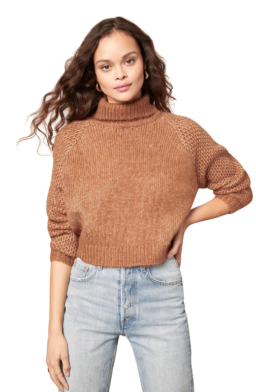 dolman sweater with a chunky foldover turtleneck and textured knit sleeves.