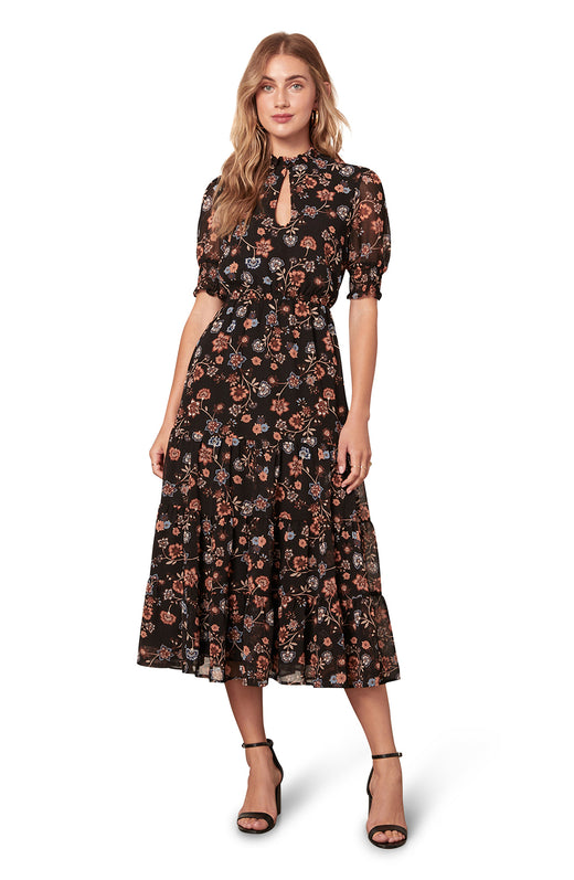 black and tan multi wildflower printed chiffon midi dress with a keyhole neckline and short sleeves.