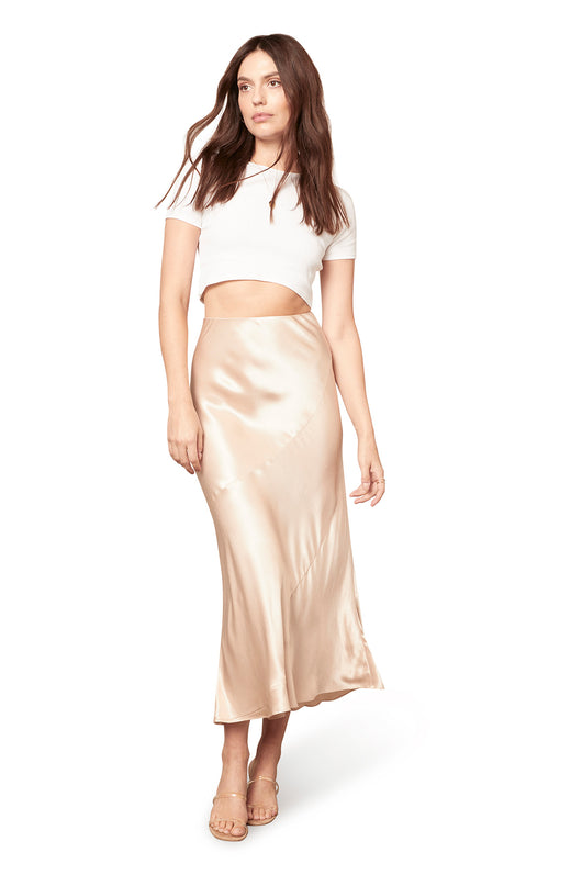 champagne colored paneled bias cut satin slip skirt in a midi length silhouette. Hidden zip closure.