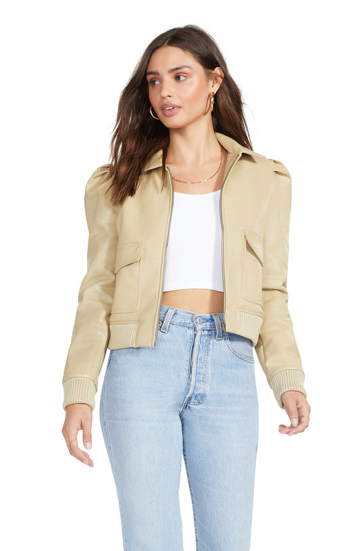 tan color leather bomber jacket with puff sleeves, rib detailing, and flap pockets.