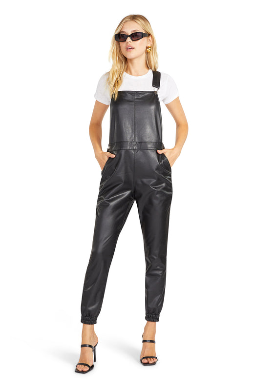 fitted vegan leather jumpsuit with a jogger style tapered leg and pockets.