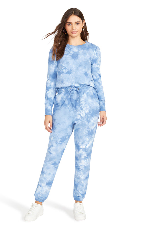 blue tie dye printed fleece sweatpant with a tapered elastic-trim ankle, pockets, and a high-rise drawstring waist.