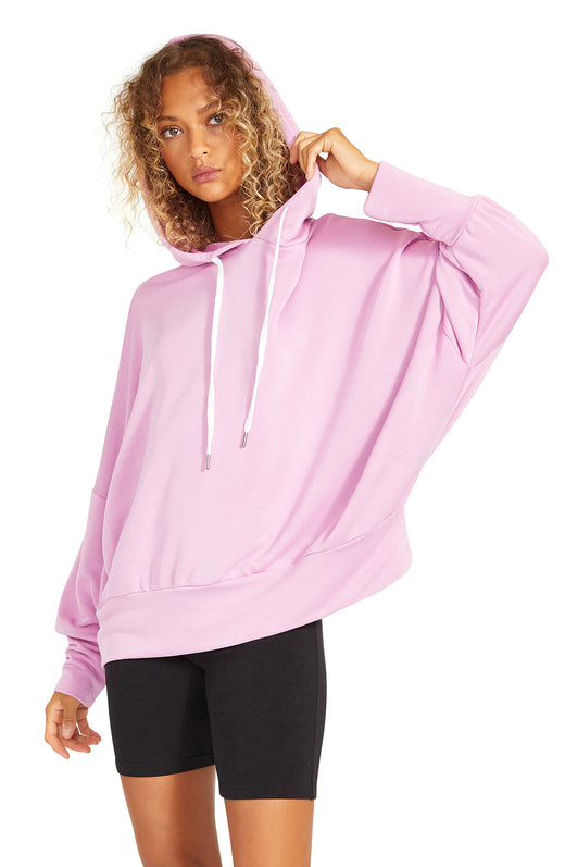lilac  terry pullover sweatshirt with an oversized dolman silhouette.