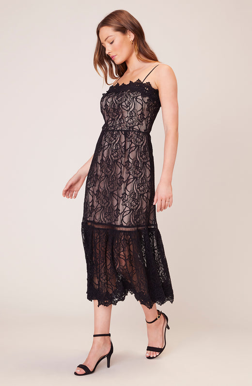 Model wearing black lace midi dress