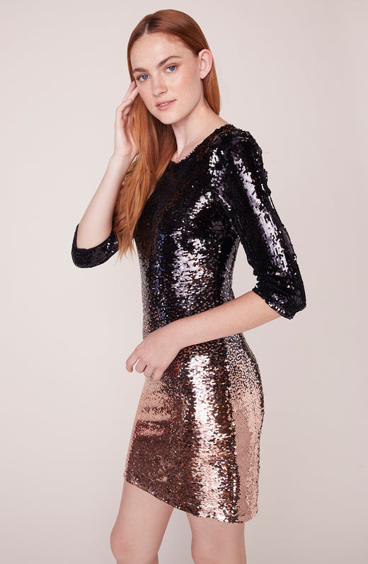 Side view of model wearing ombre sequin dress