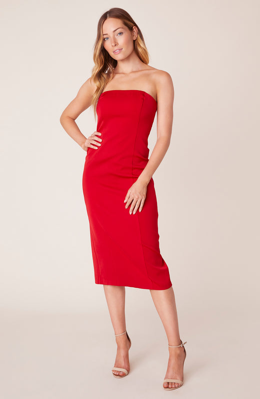 Front view of model wearing strapless red midi dress
