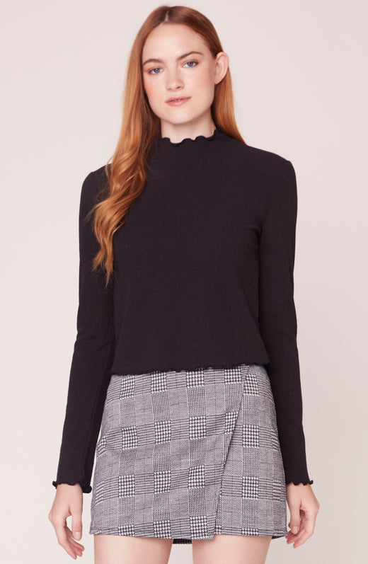 Front view of model wearing turtle neck top