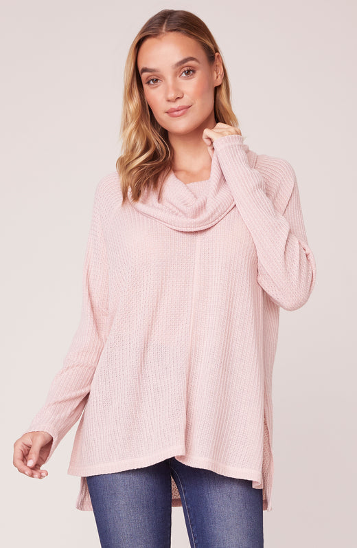 Model wearing cowl neck long sleeve pink sweater