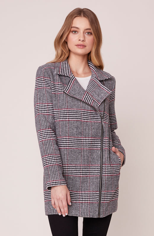 Model wearing zip-up plaid coat