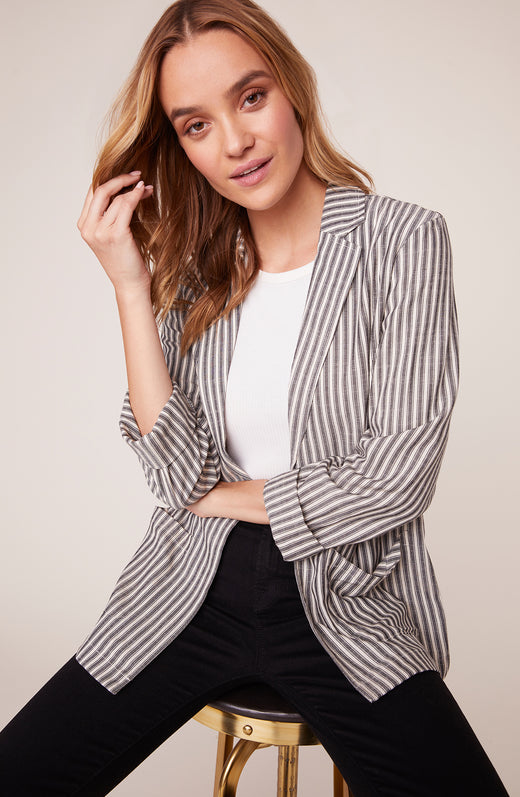 model wearing striped boyfriend blazer