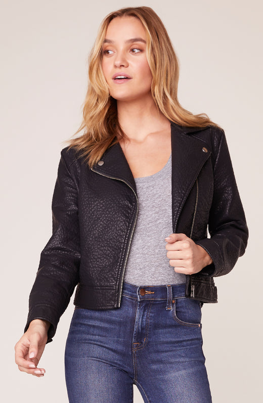 Model wearing textured vegan leather jacket in black