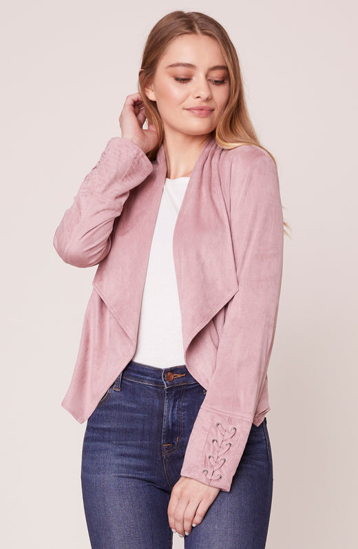 Model wearing faux suede pink jacket