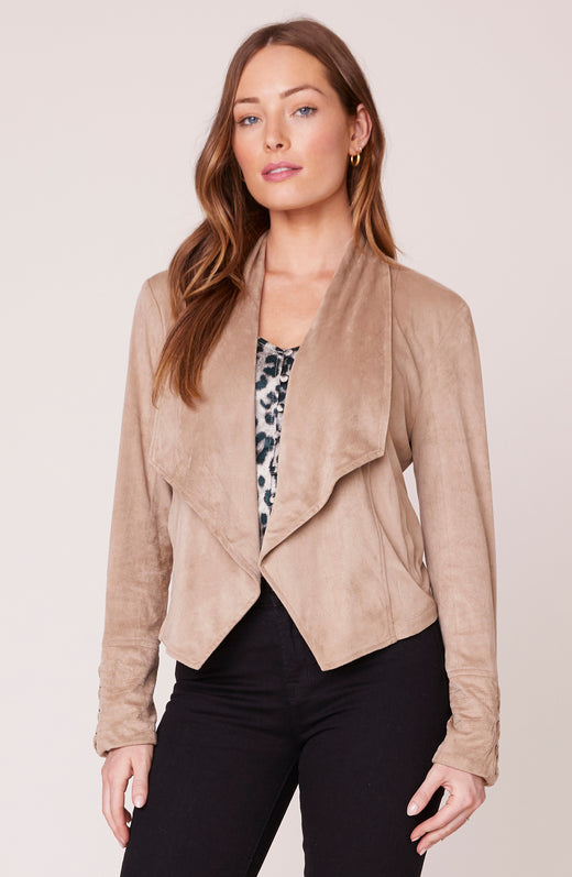 Model wearing faux suede tan jacket