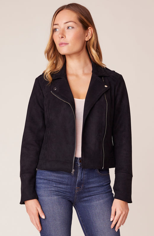 Model wearing black suede moto jacket