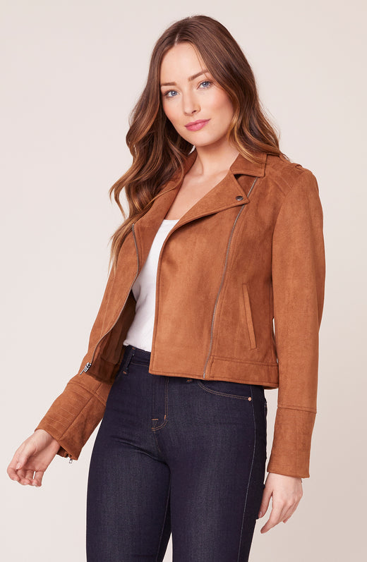 Model wearing tan suede moto jacket