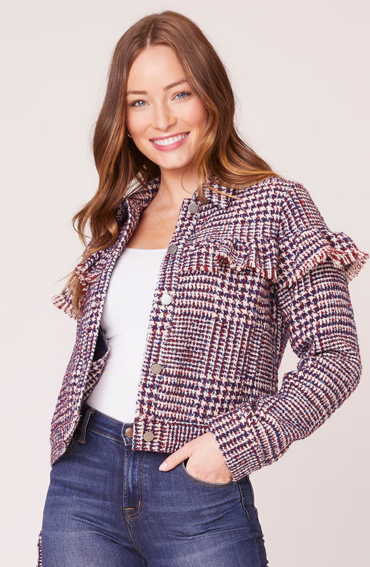Model wearing plaid jacket with ruffle detail