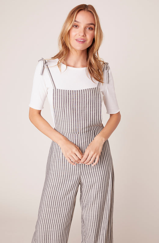model wearing striped overalls