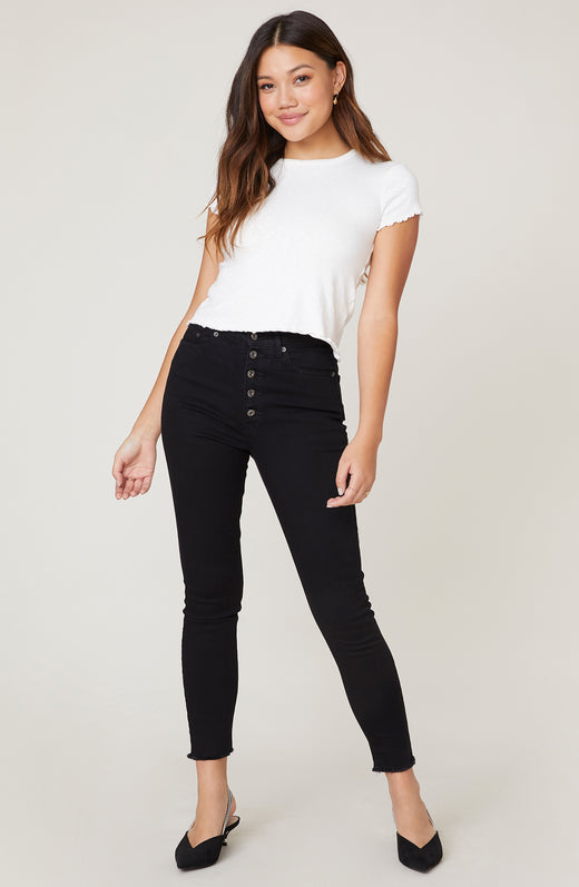 Model wearing high waisted black skinny jeans