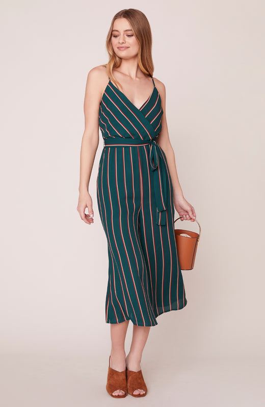 Model wearing green striped jumpsuit with cropped legs
